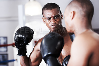 Buy stock photo An african american boxer about to deliver a knockout punch