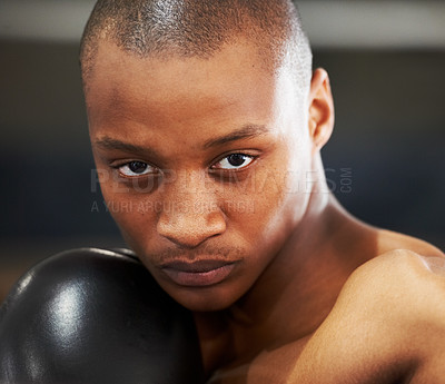 Buy stock photo A young boxer with determination and focus in his eyes