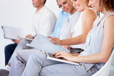 Buy stock photo A line of business colleagues taking notes during a seminar