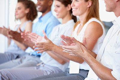 Buy stock photo A line of businesspeople applauding a great presentation