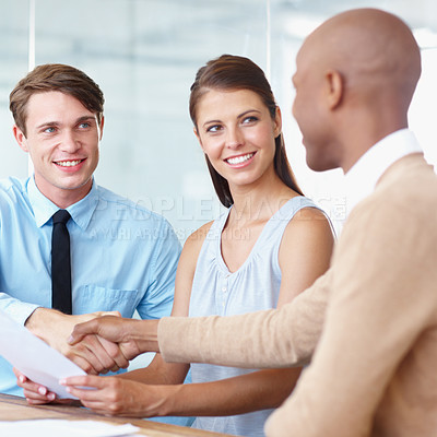 Buy stock photo An african american businessman being welcomed into the company by his new colleagues