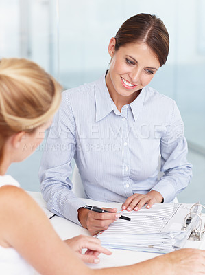 Buy stock photo Two businesswoman going over a daily planner together in the office