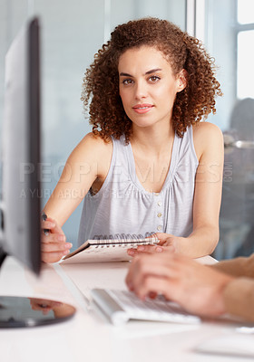 Buy stock photo A beautiful young businesswoman working with a colleague in the office