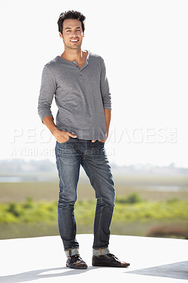 Buy stock photo Full length portrait of a handsome young man standing outside with his hands in his pockets