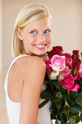 Buy stock photo A young woman looking happy to get flowers