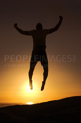 Buy stock photo Silhouette of a man jumping in the air with the sunset in the background