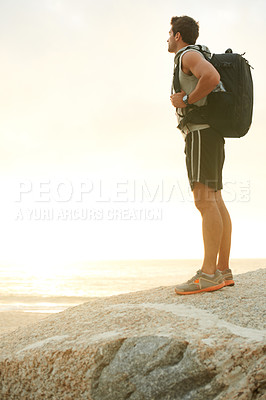 Buy stock photo Young hiker standing and looking at the view