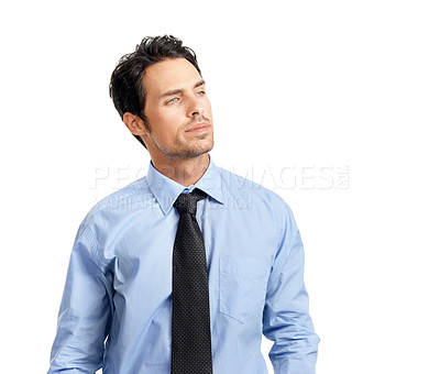 Buy stock photo Studio shot of a handsome businessman looking away thoughtfully