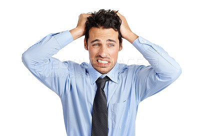 Buy stock photo Studio shot of a frustrated businessman with his hands in his hair