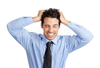 Buy stock photo Frustrated young businessman with his hands in his hair
