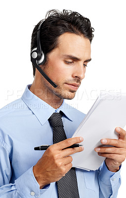 Buy stock photo A handsome customer service agent checking documents while talking on the phone