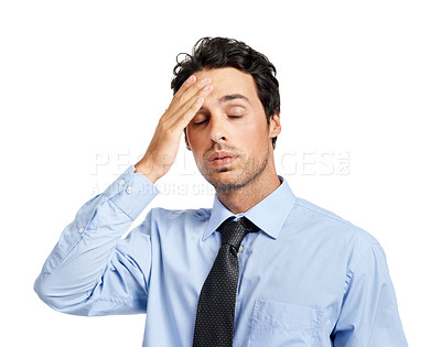 Buy stock photo Studio shot of a tired businessman posing against a white background