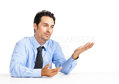 Buy stock photo A young business executive explaining something against a white background