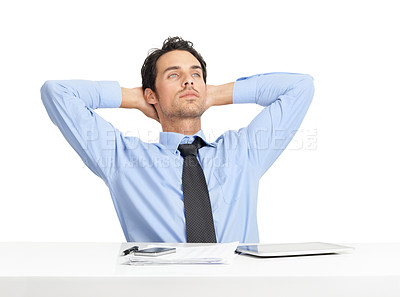 Buy stock photo A relaxed young businessman sitting at his desk