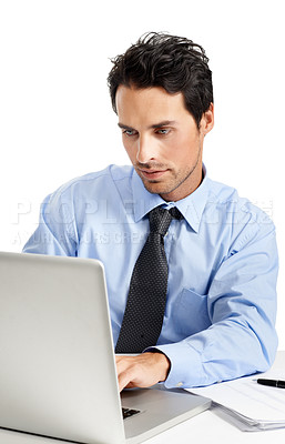 Buy stock photo Studio shot of a handsome businessman working on his laptop