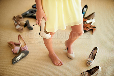 Buy stock photo Cropped image of a woman standing in her room surrounded by shoes