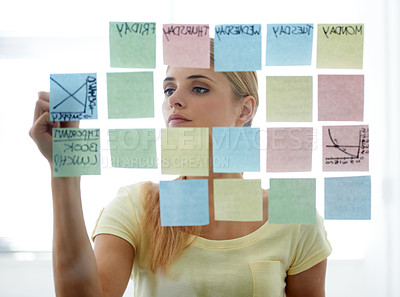 Buy stock photo Cropped shot of an attractive young woman working in her office