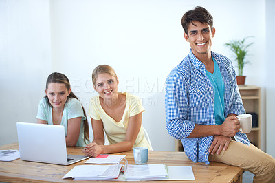 Buy stock photo Cropped shot of three colleagues working in an office