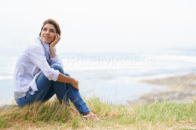 Buy stock photo Shot of a mature woman taking a break from her walk to take in the scenery