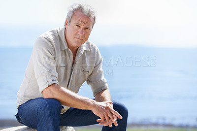 Buy stock photo Portrait of a mature man sitting outdoors