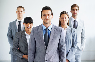 Buy stock photo Portrait of a confident business team standing together in the office