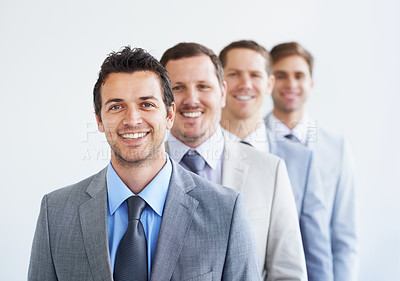 Buy stock photo Portrait of a group of smiling businessman standing in a line