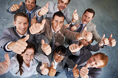 Buy stock photo Top view of a successful business team giving you an emphatic thumbs up
