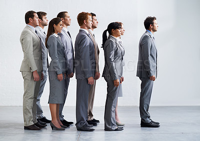 Buy stock photo A group of young businesspeople standing in a line and looking away - Full body & Profile