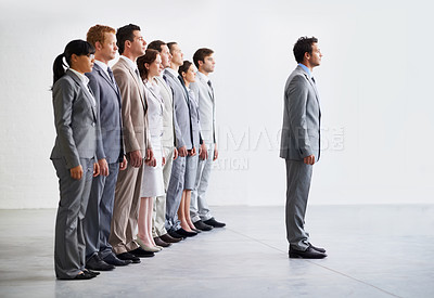 Buy stock photo A young business team awaiting the verdict on their business presentation