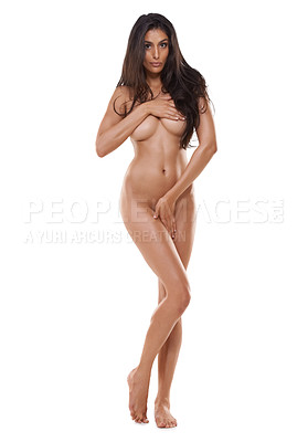 Buy stock photo Shot of a nude woman posing in a studio