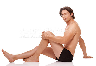 Buy stock photo Studio shot of a handsome man posing in his underwear against a white background
