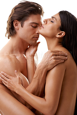Buy stock photo Shot of a passionate couple making love against a white background