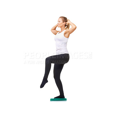 Buy stock photo Full length studio shot of an attractive woman doing balancing exercises isolated on white