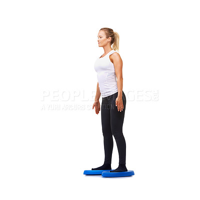 Buy stock photo Full length studio shot of a young woman doing exercises isolated on white