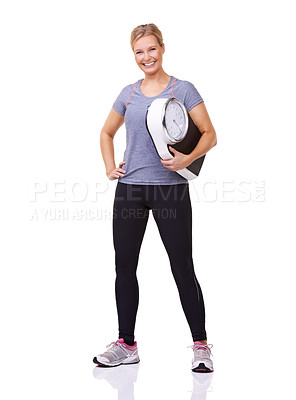 Buy stock photo Studio portrait of an attractive and sporty young woman holding a scale and  smiling at the camera isolated on white