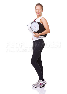 Buy stock photo Studio portrait of a  young woman holding a scale and  smiling at the camera isolated on white