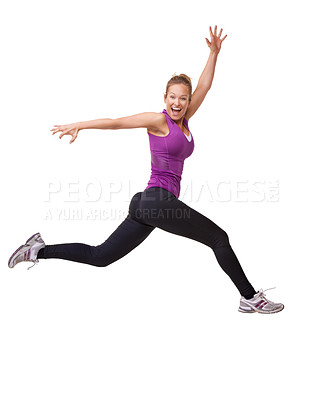 Buy stock photo Studio shot of an energetic young woman leaping through the air across the frame isolated on white