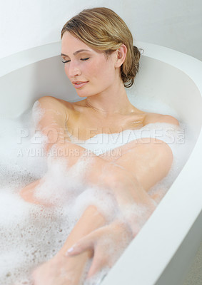Buy stock photo A beautiful young woman closing her eyes and enjoying a luxurious bath