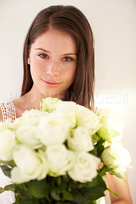 Buy stock photo Portrait of a beautiful young woman smiling and holding a bouquet of flowers