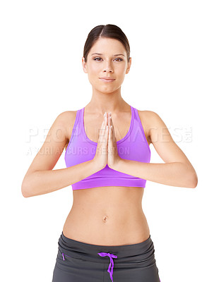 Buy stock photo Studio portrait of an  young woman in workout clothing holding her palms together in a meditative pose isolated on white