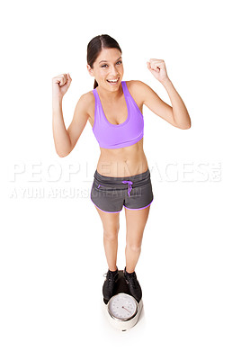 Buy stock photo Full length high angle shot of an ecstatic young woman weighing herself on a scale isolated on white
