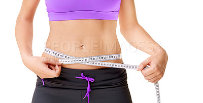 Buy stock photo Cropped shot of a woman wearing sporty clothing measuring her waistline isolated on white