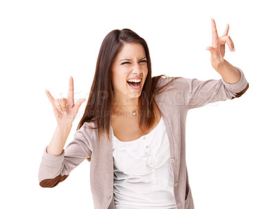 Buy stock photo Studio shot of a beautiful young woman gesturing with both hands in the rock-on style