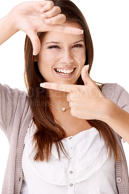 Buy stock photo Studio shot of a beautiful young woman making a frame with her fingers against a white background