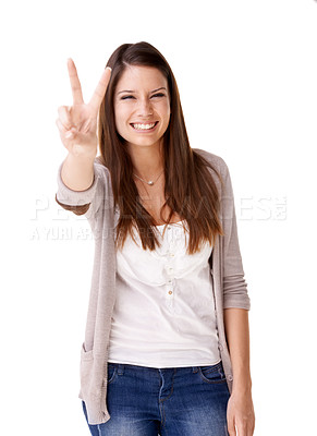 Buy stock photo Smiling young woman giving a peace sign against a white background