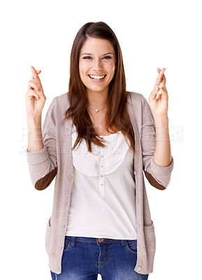 Buy stock photo Smiling young woman with her fingers crossed against a white background