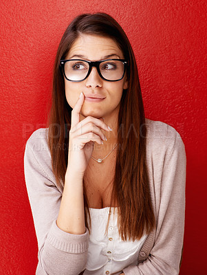 Buy stock photo Cropped view of a young woman wearing glasses and looking away