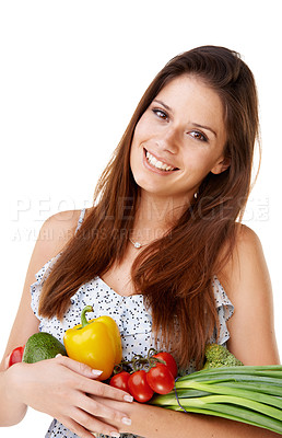 Buy stock photo Portrait of an attractive young woman holding a bunch of vegetables