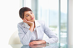 Business woman sitting  looking away lost in thought