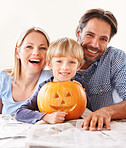 A family behing their jack-o-lantern